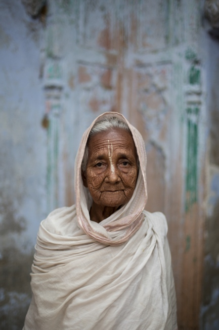 """Indian widow Saraswati Thanedar, 75, poses for a photograph at the Meerasahabhagini Ashram in Vrindavan, some 135 kilometres (80 miles) south of New Delhi on March 5, 2014. Thanedar has lived at the ashram for ten years and says, """"I love it here. Everything is good. I don't go back now that I live here."""""""