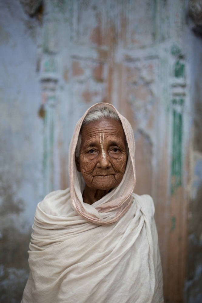 "Indian widow Saraswati Thanedar, 75, poses for a photograph at the Meerasahabhagini Ashram in Vrindavan, some 135 kilometres (80 miles) south of New Delhi on March 5, 2014. Thanedar has lived at the ashram for ten years and says, ""I love it here. Everything is good. I don't go back now that I live here."""
