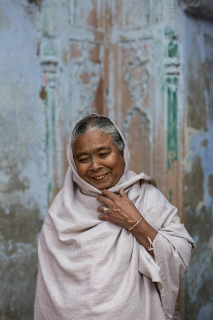 """Indian widow Hasidev Nath, 66,poses for a photographat the Meerasahabhagini Ashram in Vrindavan, some 135 kilometres (80 miles) south of New Delhi on March 5, 2014.Nath has lived at the ashram for 26 years and says, """"The ashram is better than home. Lal Baba (the head of the Sulabh International NGO) takes care us of all."""""""