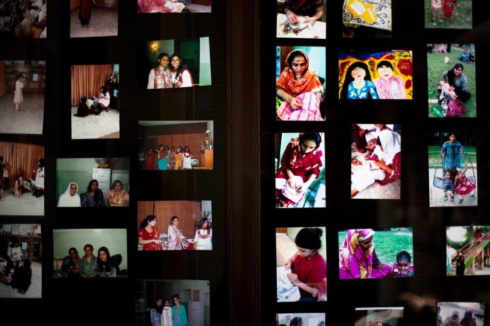 Photographs of past Pakistani residents are seen on the wall at the Dastak women's shelter in Lahore on February 20, 2013.