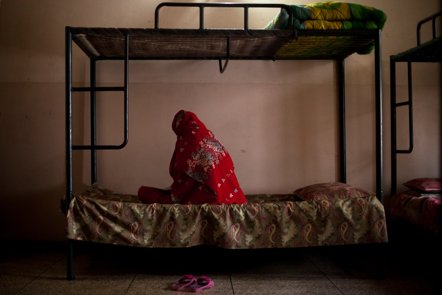 A Pakistani resident reads the Quran at the Dastak women's shelter in Lahore on February 22, 2013.