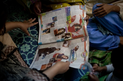Pakistani residents read a magazine at the Dastak women's shelter in Lahore on March 4, 2013.