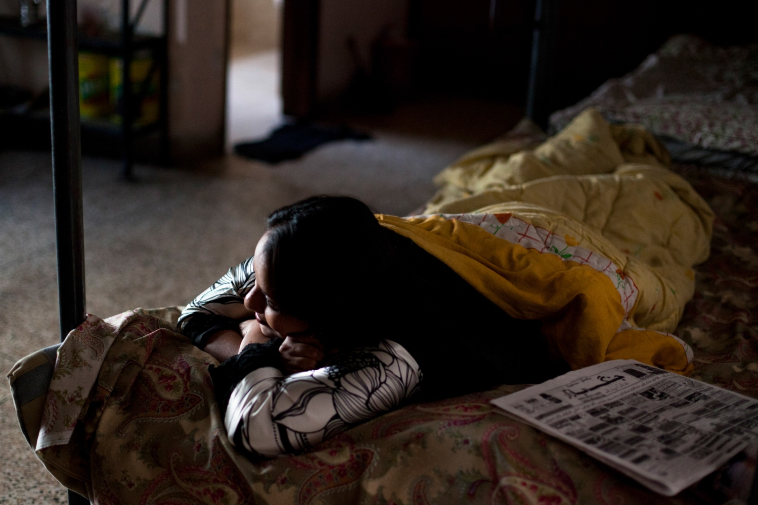 A Pakistani resident rests in a bedroom at the Dastak women's shelter in Lahore on March 4, 2013.