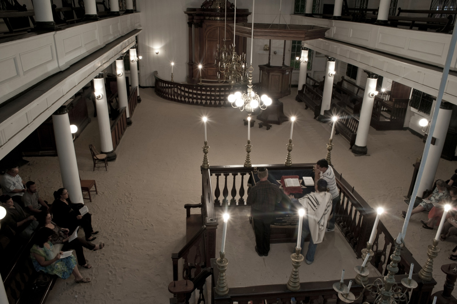 Sabbath evening services at the synagogue. It is one of five functioning synagogues in the world with sand floors, a tradition dating back to the 17th century.