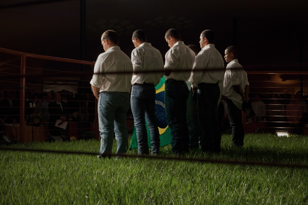 Cowboys sing the national hymn in a private luxury cattle's auction opening during ExpoZebu Cattle Fair. Uberaba, Brazil, 2013