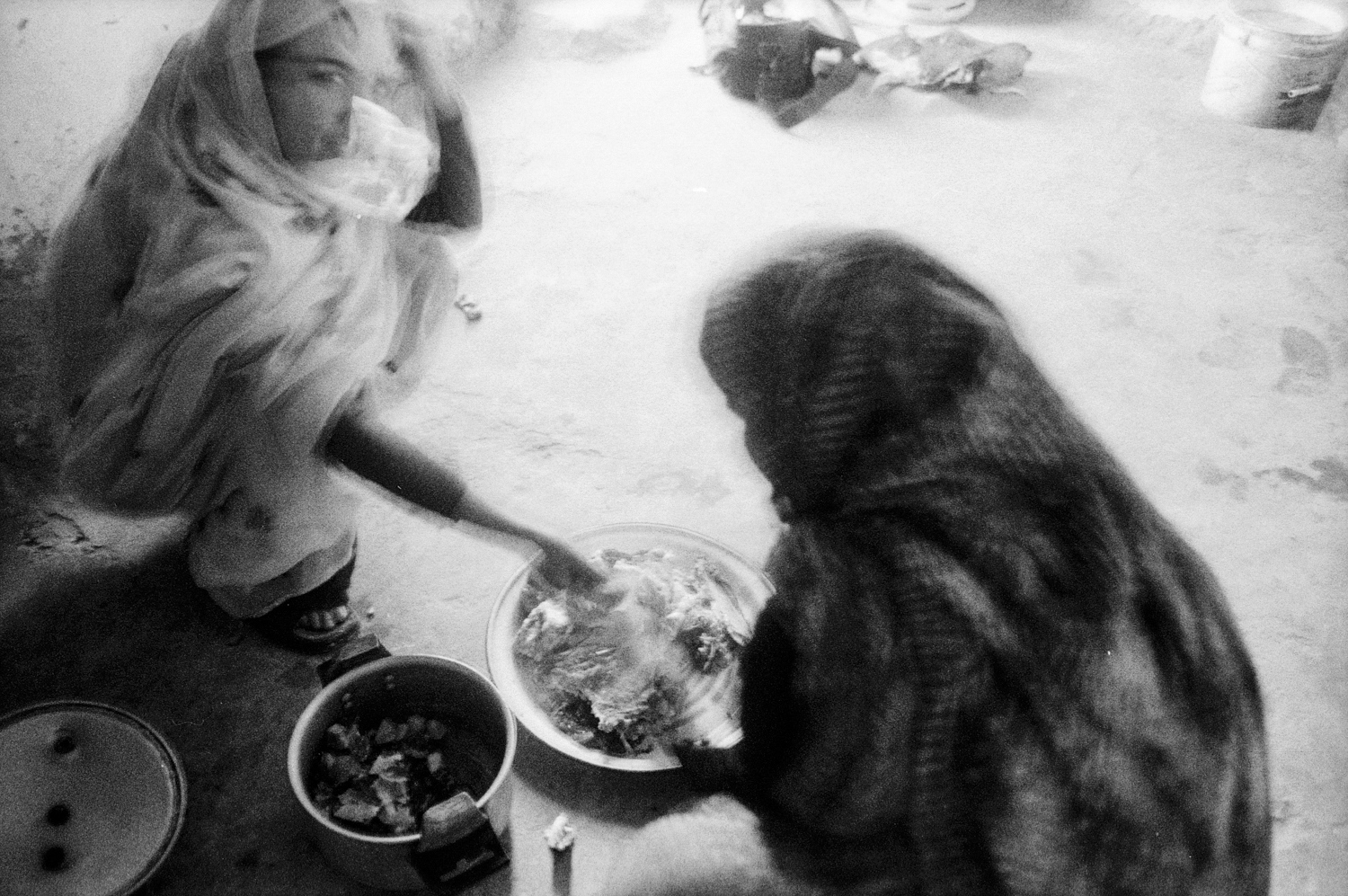 Two woman cocking at Sahrawi's refugee camps, Tindouf, Algeria.