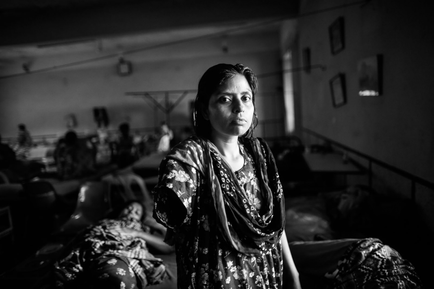 Shilpi, who was rescued from the rubble of the collapsed Rana Plaza building, stands inside the Centre for Rehabilitation of Paralysis (CRP) in Savar.