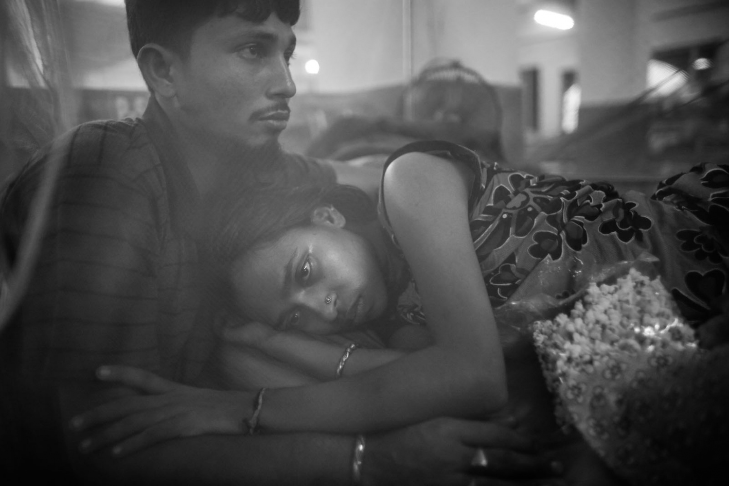 Fear is all Rebecca has now. She lives her trauma over and over. Rebecca was among those trapped under the rubble of Rana Plaza. Her husband Mustafiz tries to comfort her at the National Traumalogy and Orthopaedic Rehabilitation Centre.