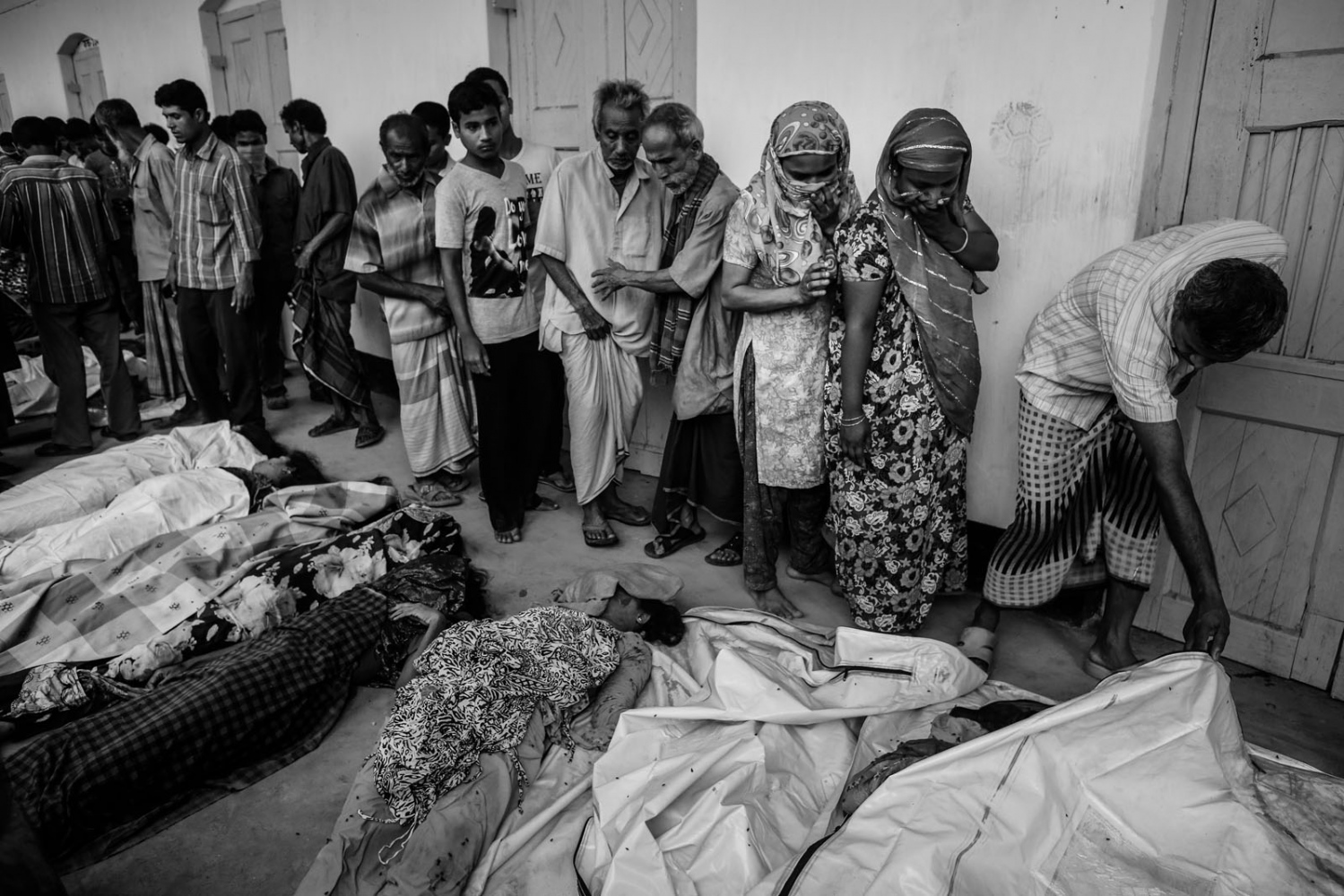 People try to identify their relatives, who died inside the rubble of the collapsed Rana Plaza building, in Savar, 30 km (19 miles) outside Dhaka.