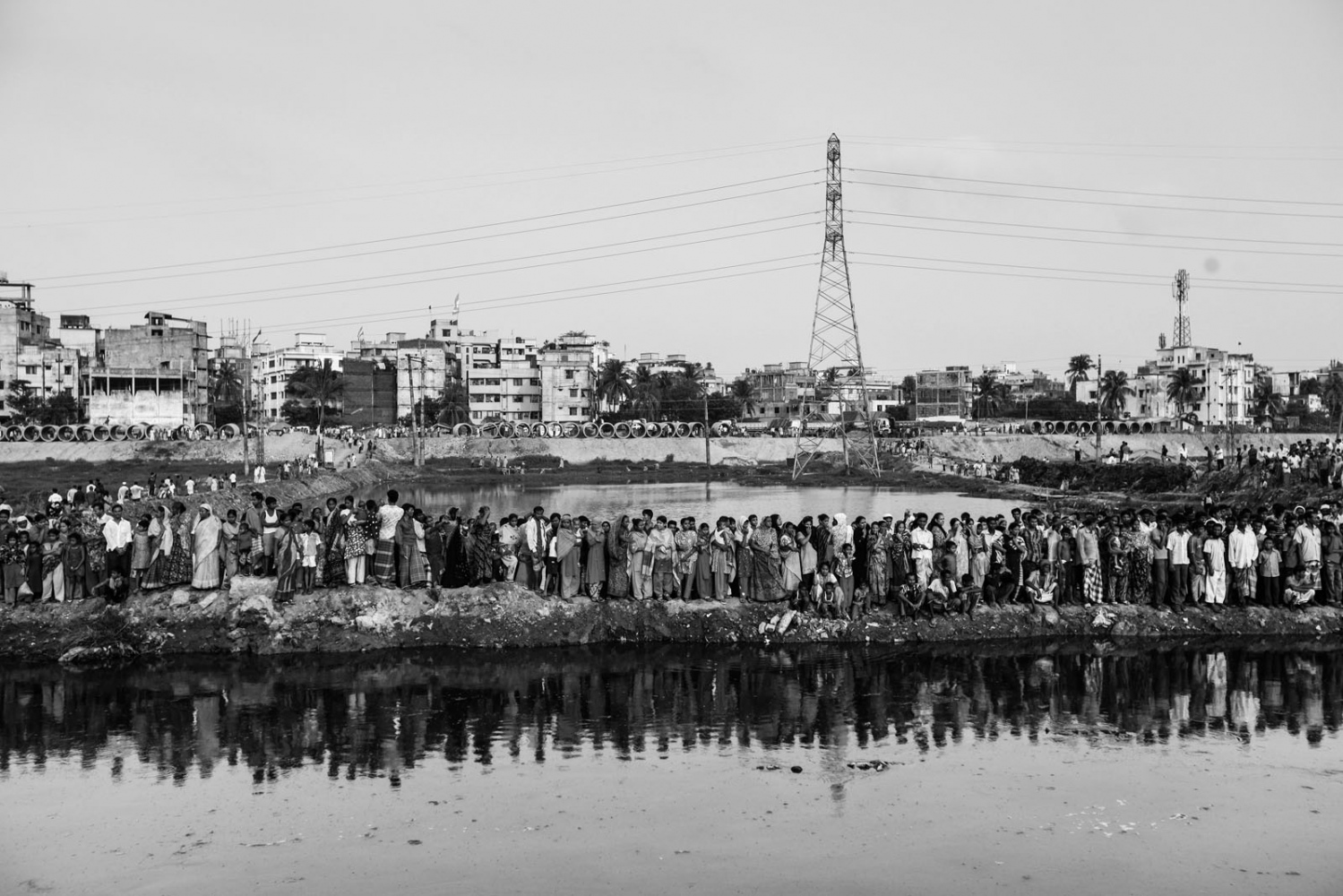 People gather at a site to watch a rescue operation, after a five-storey building collapsed off its base, in the Begunbari area in Dhaka. The building collapsed, flattening several adjacent homes and killing at least 9 people, with dozens more trapped under the rubble, police and witnesses said. At least 50 people were injured in the collapse of the building, most of them are the garment workers and their relatives. More than four million people, mostly women, work in Bangladesh's clothing sector, which is the country's largest employment generator, with annual exports worth $21 billion.