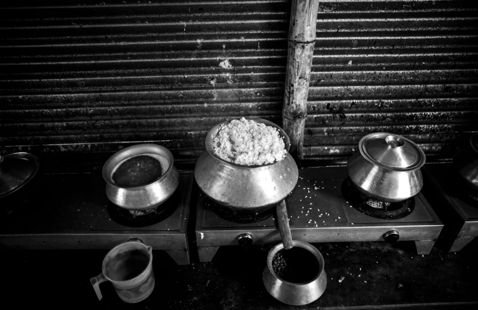 Rice has been prepared for lunch at a slum in Mirpur, Dhaka. Most of the inhabitants of the slum are low-paid garment workers, migrated from the Different districts of the Bangladesh.