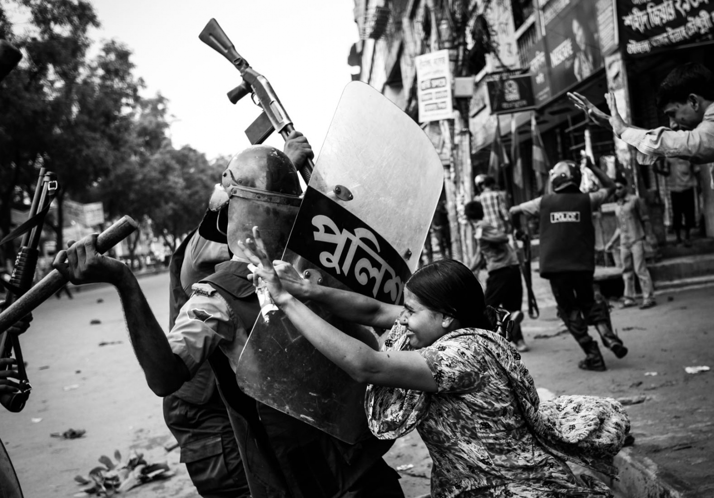 Rahela Akhter, a garment worker, tries to resist beating from the police during a protest in Dhaka. On 30th June, 2010, 80 garment workers were injured when they took to the streets demanding better pay and the police tried to 'contain' them as ordered.