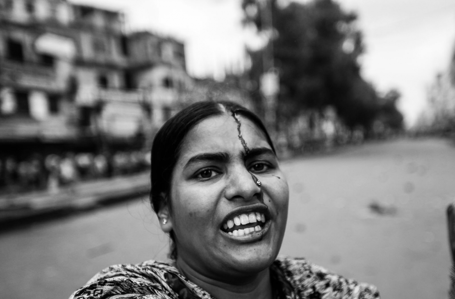 Rahela does not seem to mind the stream of blood coming down her forehead. On 30th June, 2010, 80 garment workers were injured when they took to the streets demanding better pay and the police tried to 'contain' them as ordered
