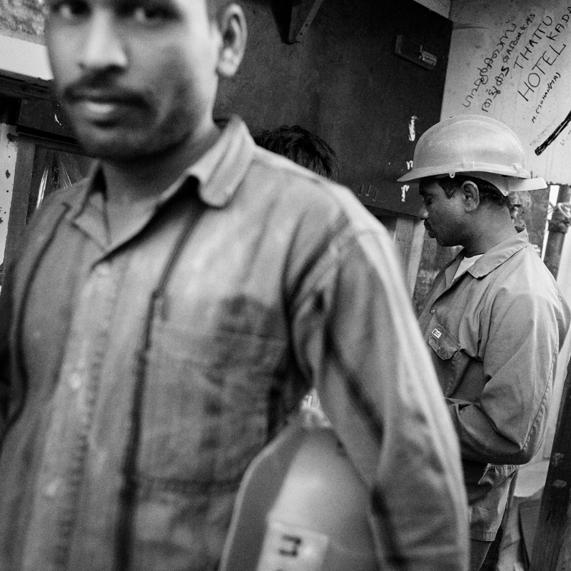 Construction workers enjoy a chai break.