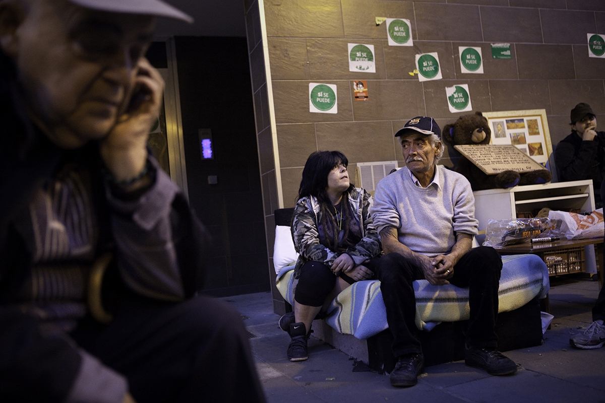 Elisabeth Garcia and his father Manolo, passing night in the street with all their belongings after police eviction of Insula Utopia, a social project that gave shelter to three homeless families and activist for three months in Nou Barris district (Barcelona).