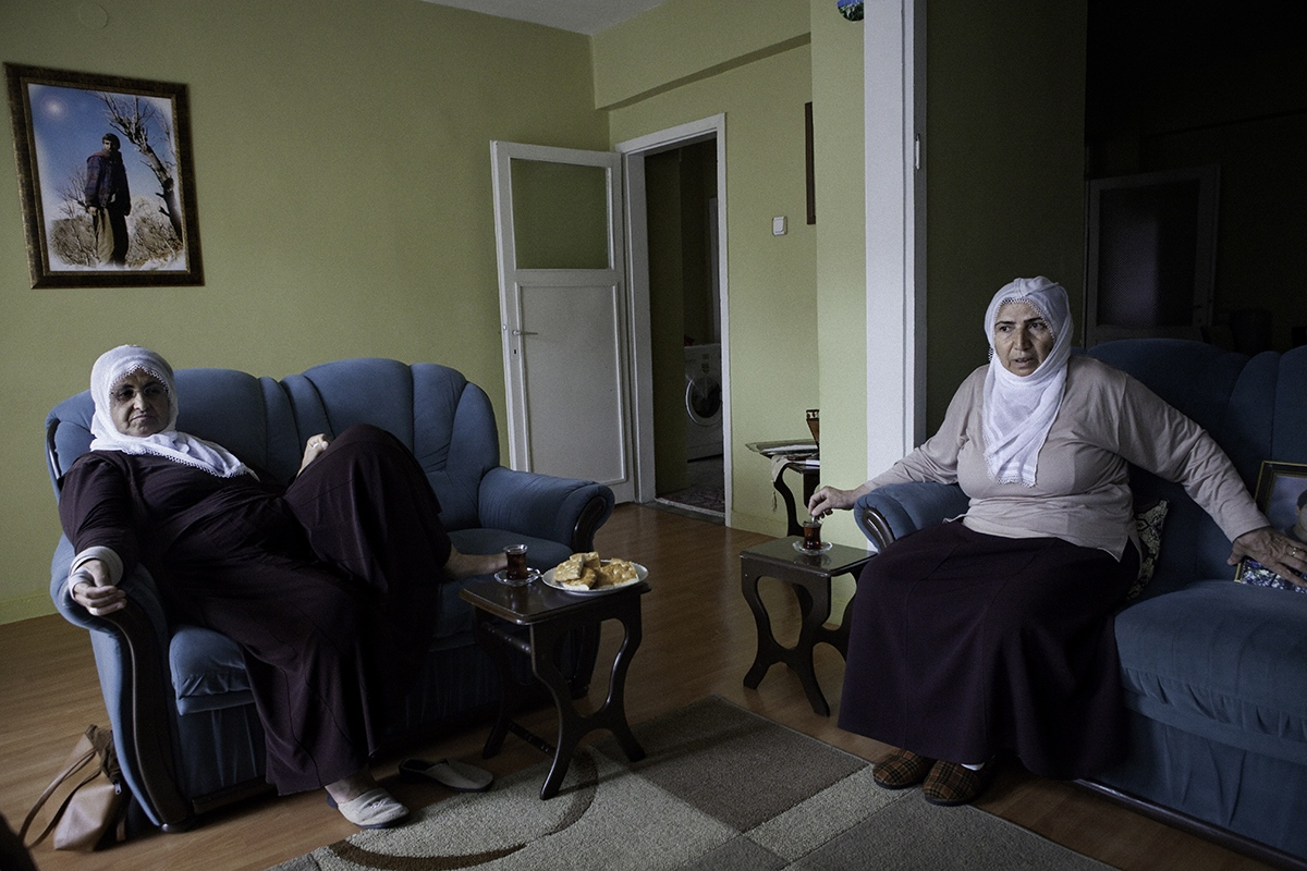 Two members of Mothers for Peace association have a rest at home, in Diyarbakir city.