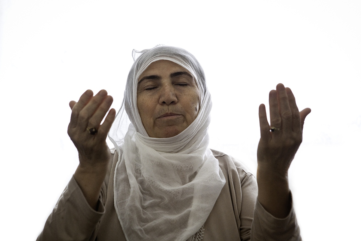 "Morning prayer ( Dua ) for Sebiha. Her son went to the mountains to join the Kurdish guerrillas over 15 years ago and has not heard from him since then. Sebiha is a member of the association ""Mothers for Peace"" in Diyarbakir."