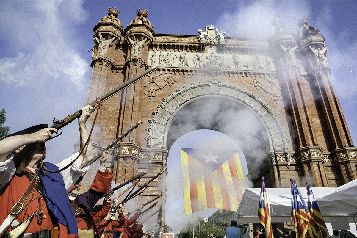 "A group of 1714 reenactors from the association ""Miquelets de Catalunya"" shoot their guns in front of Arc de Triomf monument in Barcelona, during official acts of 11th of september, the National Day of Catalonia. Reenactors commemorate the tercentenary of the lost of Barcelona in Succession war in 1714."