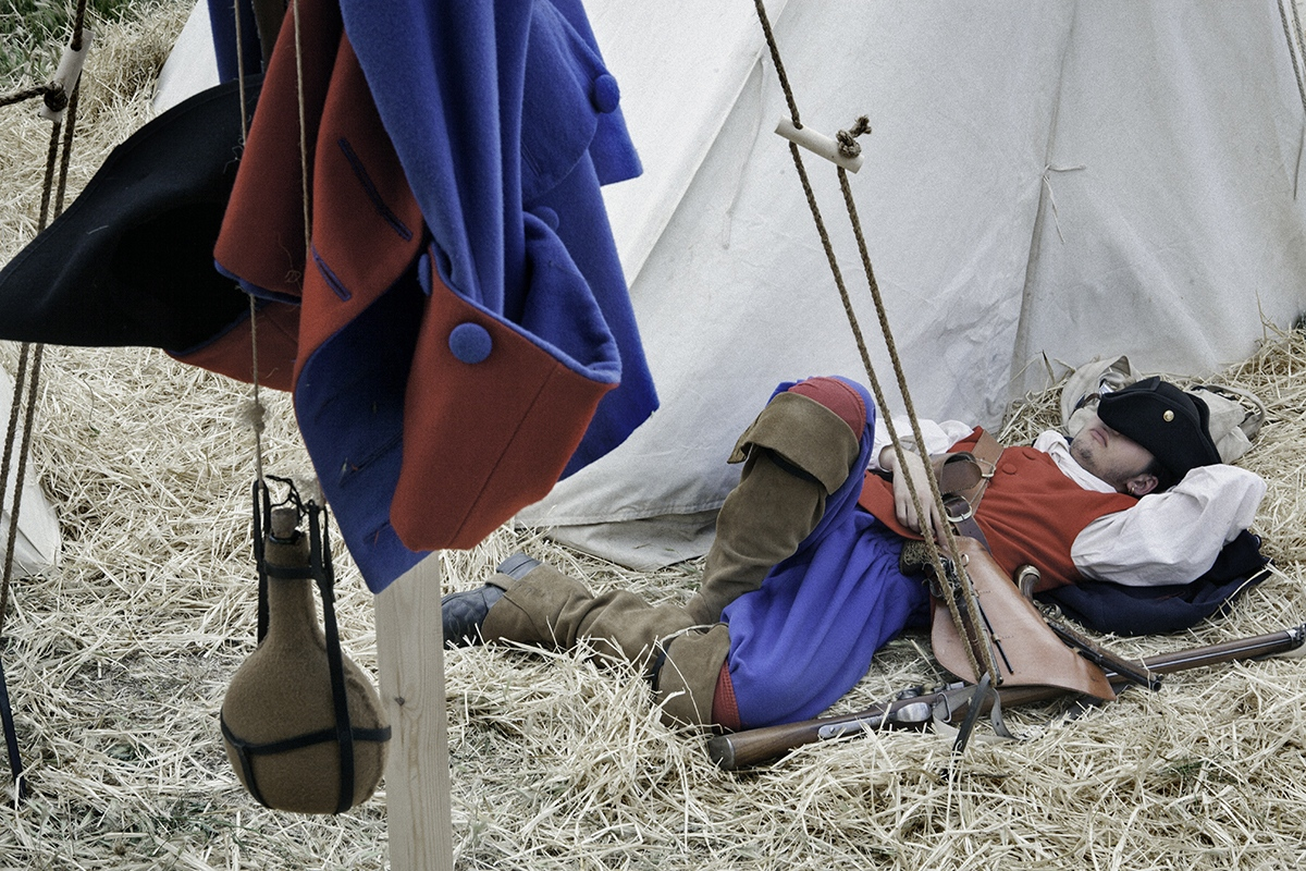 "A member of ""Miquelets de Catalunya"" take a rest dressed as a XVIIIth century soldier."
