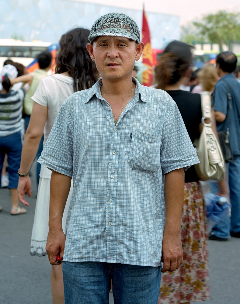 "Zhang Hui, 36, with his DIY ""Bird's Nest"" cap, from Shenyang, China."