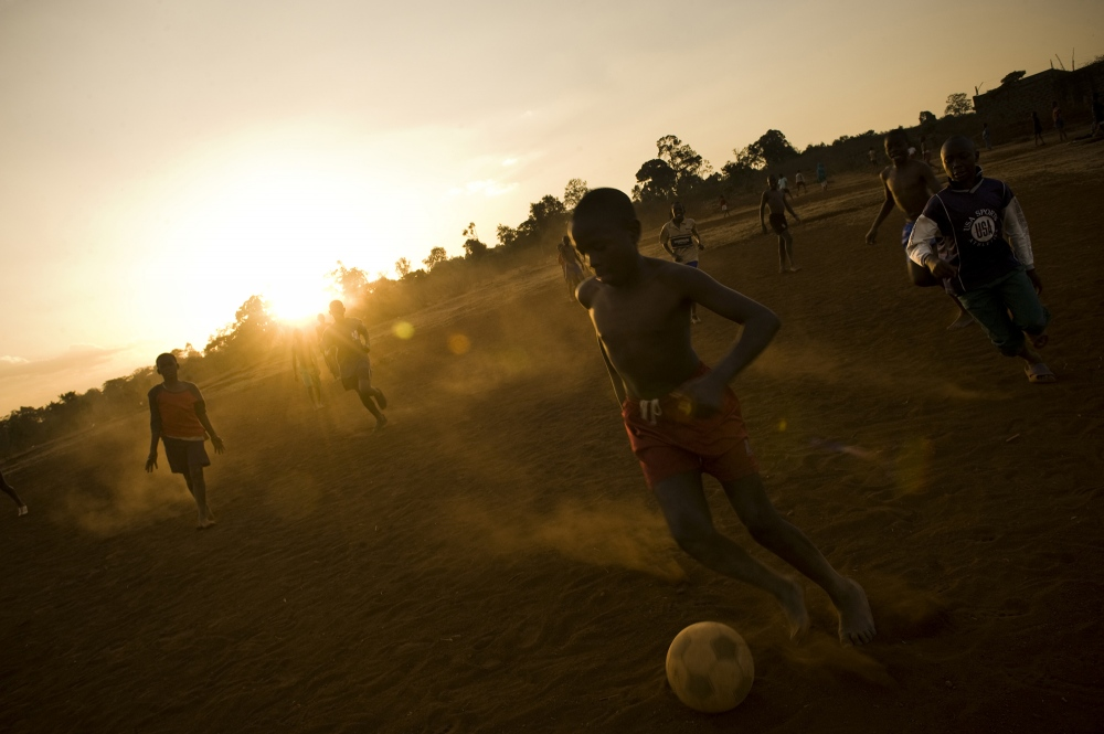 Kenya. Children playing soccer in the Kibera slum. Kibera is Africa`s next largest slum and located in Nairobi.