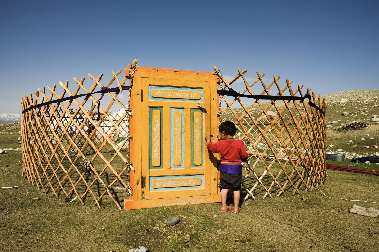 Mongolia. Kazakh nomads during setup of a ger.