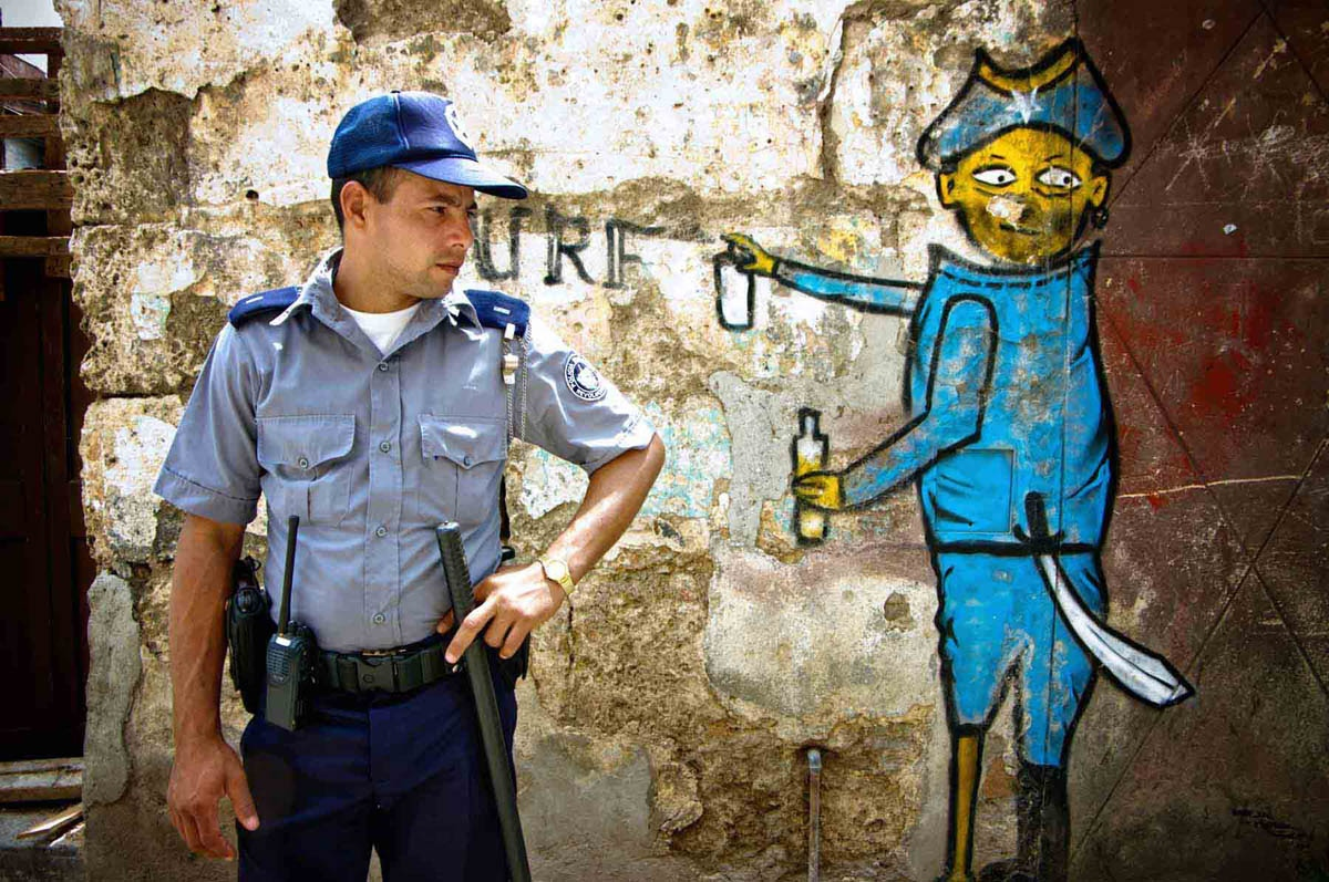 Policemen and graffiti in Havana, Cuba