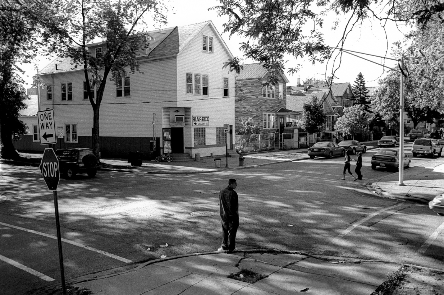 Michael waits for a friend at the corner of 48th and Loomis in the Back of the Yards neighborhood of Chicago. Originally the Back of the Yards neighborhood consisted of immigrants from Eastern Europe and over time became predominately latino.