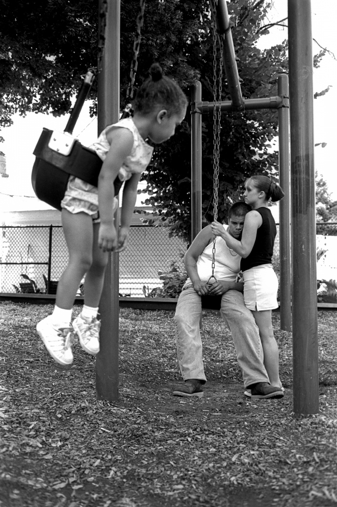 Stephanie holds her boyfriend in Laflin Park while watching his daughter. Stephanie is trying to get custody of the gril because the birth mom is addicted to drugs.