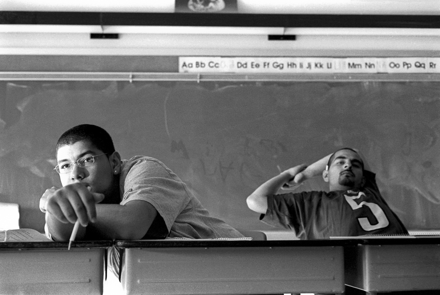 Salvador and Joe in Social Studies class at Second Chance High School. Salvador was arrested for shooting someone. Joe finished school and found work in construction.