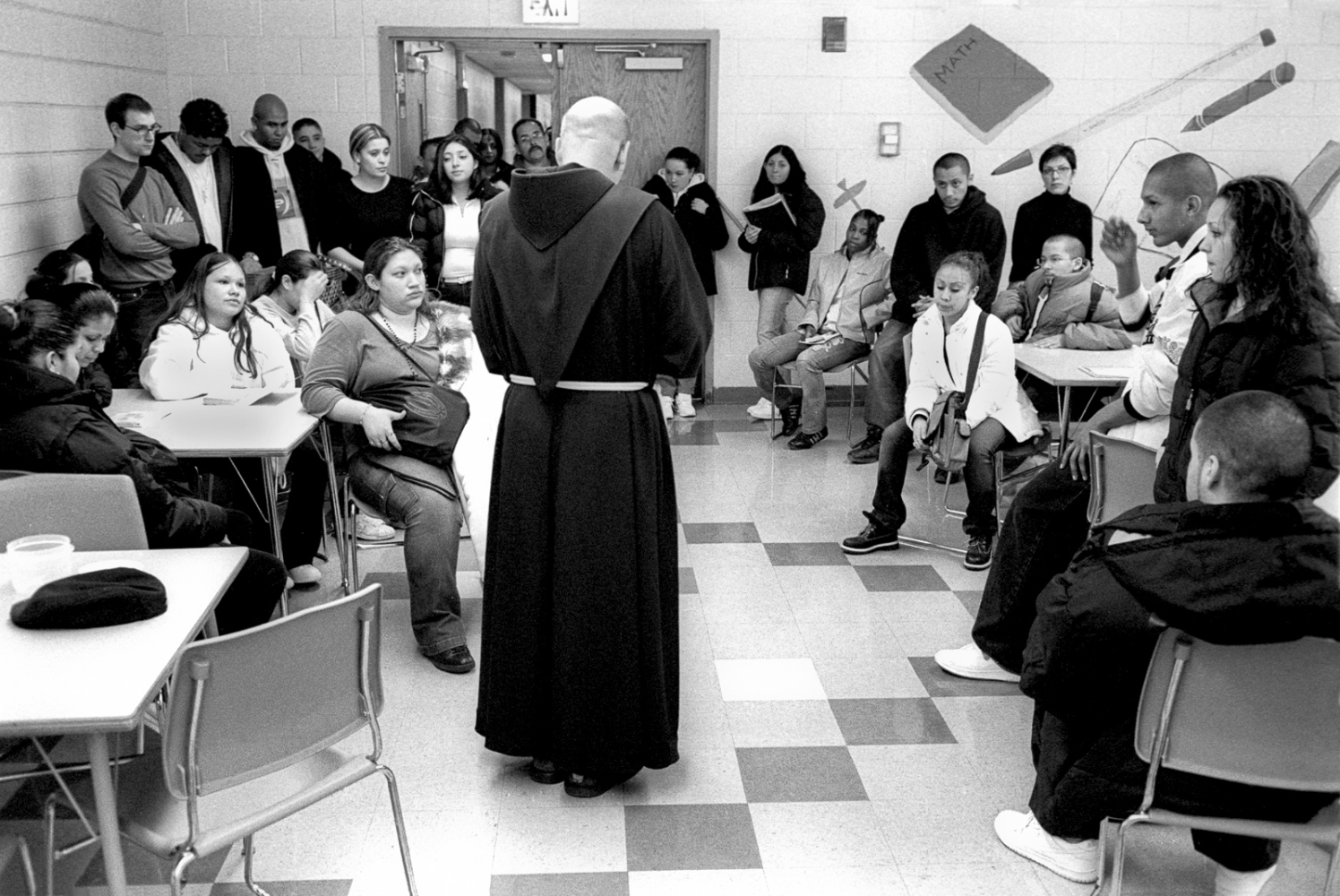 Father Shea prays with students on Ash Wednesday. He was not directly affiliated with Second Chance but Father Shea tried to maintain a constant presence in the lives of the students.