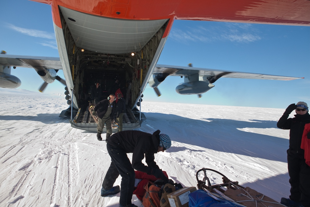 9,000 pounds of supplies are unloaded from the New York Air National Guard ski-equipped LC-130, on a remote glacier in Antarctica. It is so cold the plane has to remain powered up to avoid any risk of start-up failure. The snow was so cold and sticky the crew used rockets mounted to the side of the aircraft for an extra boost when it took off again.