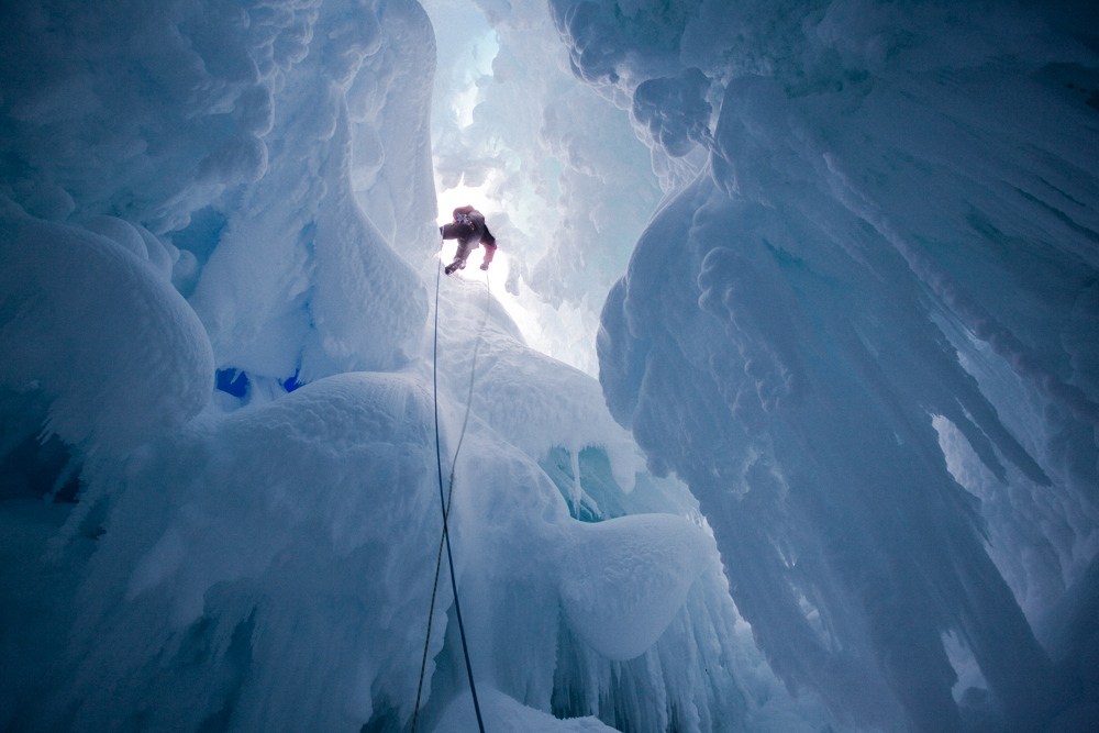 A team member descends into a crevasse on a day off from work.
