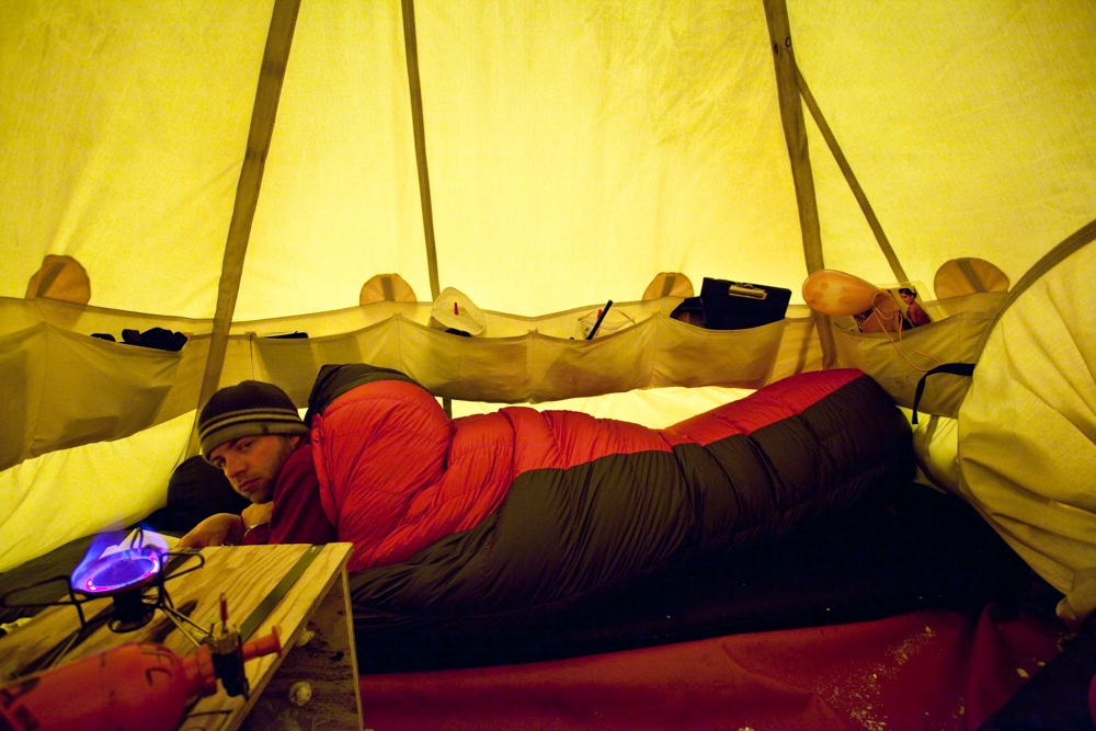 Dr. Chris Yakymchuck passes the time in the Scott Polar tent while waiting out a storm.