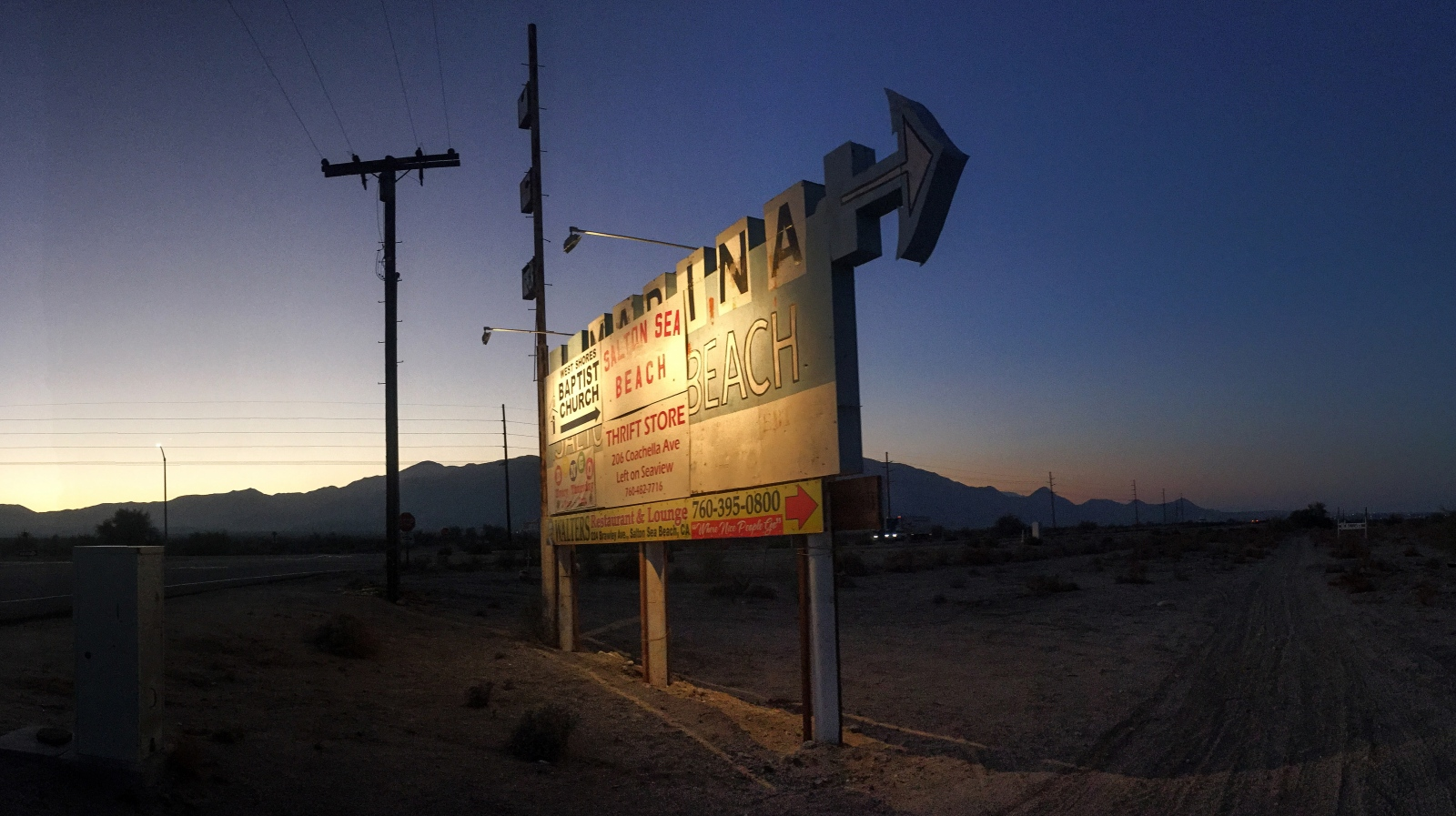 Thermal, CA, Near Salton Sea Beach - A sign posted along the side of highway 86 indicates the way to the now defunct Salton Sea Marina and Salton Sea Beach.