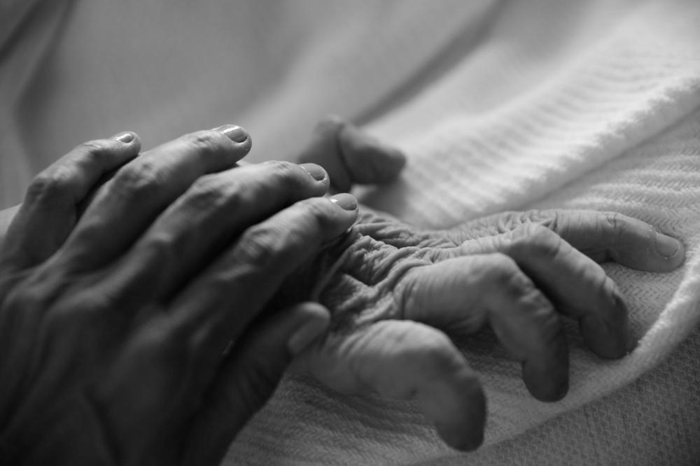 Art and Documentary Photography - Loading Hannah Kozak_He Threw the Last Punch_Our Hands.jpg