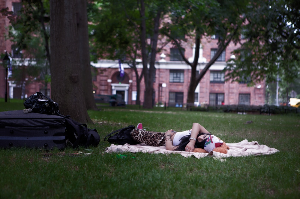 After being thrown out of a friend's apartment where her phone and money was stolen June sleeps in Washington Park with all her belongings around her.