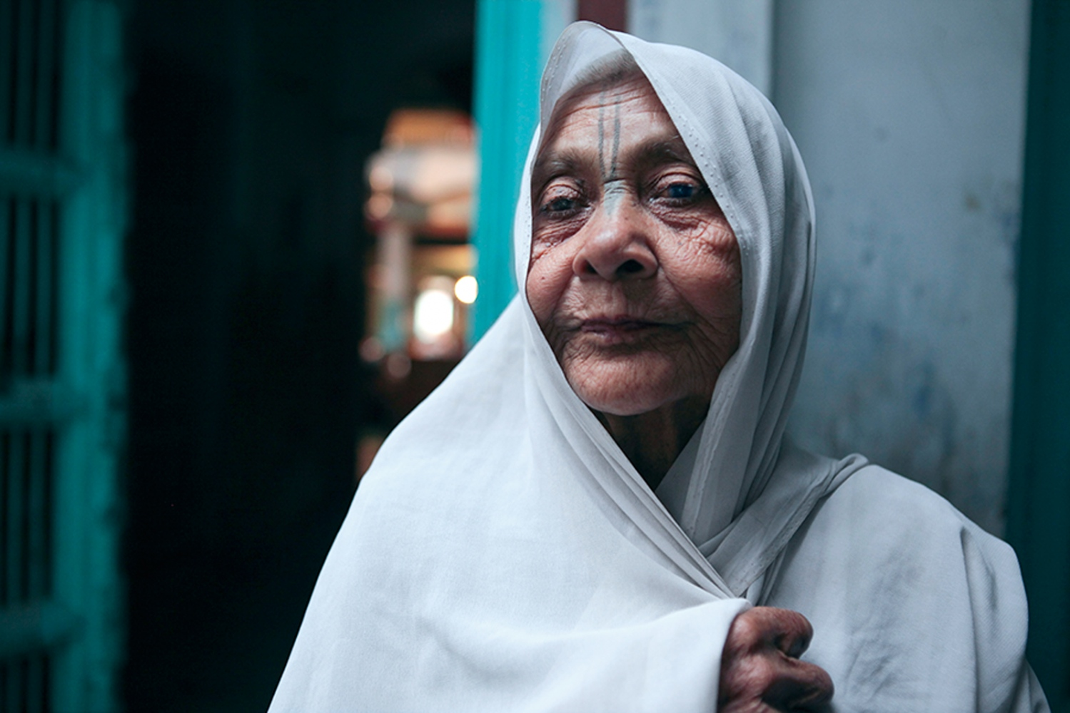 The86years old widow Rani, chantsevery dayat the ashram. Founded with the honorable intention of providing succor and safe haven to widows, has now deteriorated. Today, widows chant for seven hours a day and get paid six rupees (50 rupees=$1.)