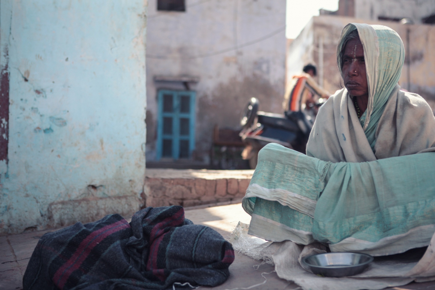 """The daily earnings of six rupees fail to support a living, leaving the widows no recourse but to beg on the streets. """"The Bhajan Ashrams are getting twenty times the amount they distribute,"""" said a resident of Vrindavan, who did not want to be named."""