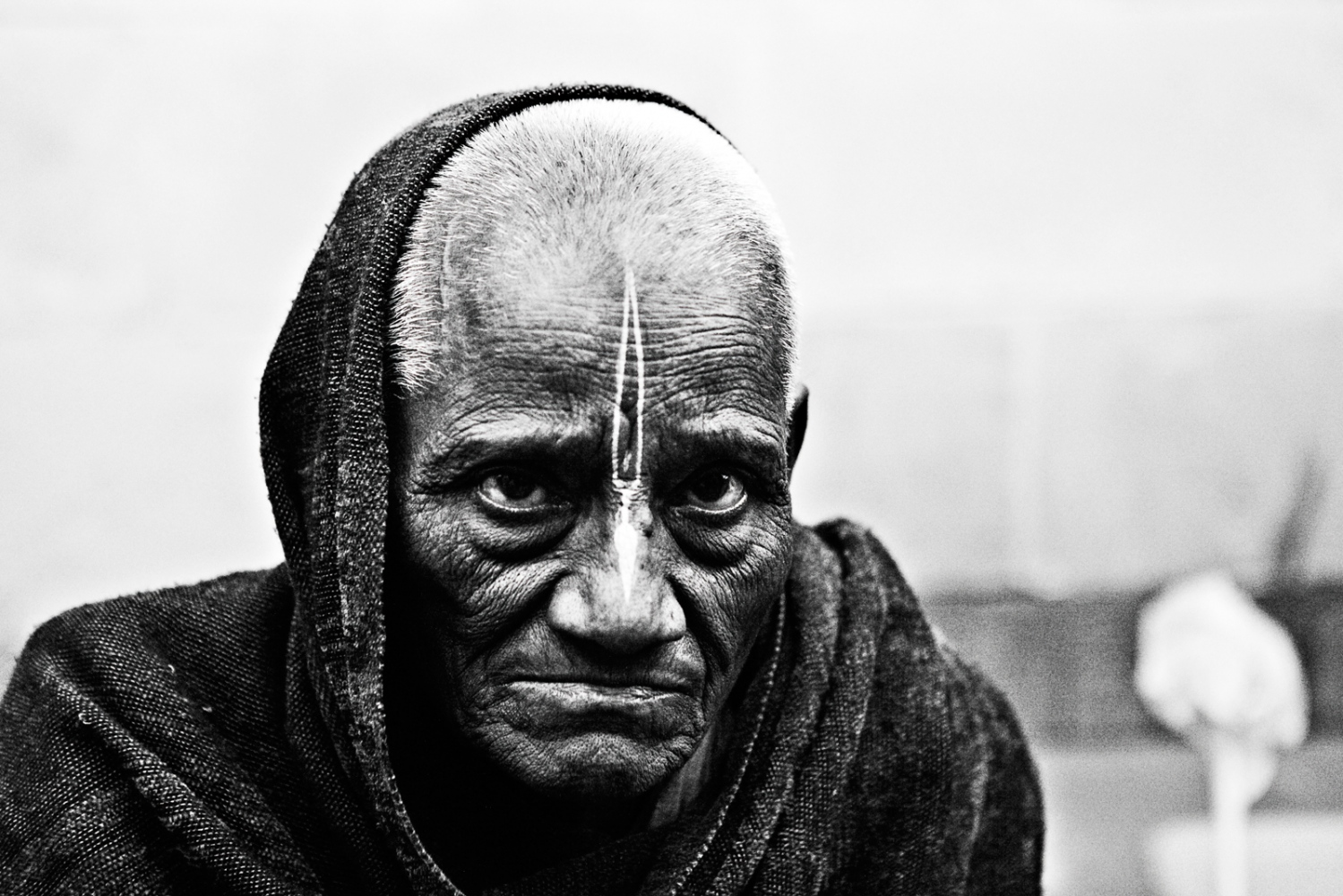Radha is 84 years old, she begs on the streets and chants at the Sri Bhayan Ashram. Her son is poor and hecouldn't take care of her back home,nine yearsago she decided to come to Vrindavan. She hasn't see her son since.