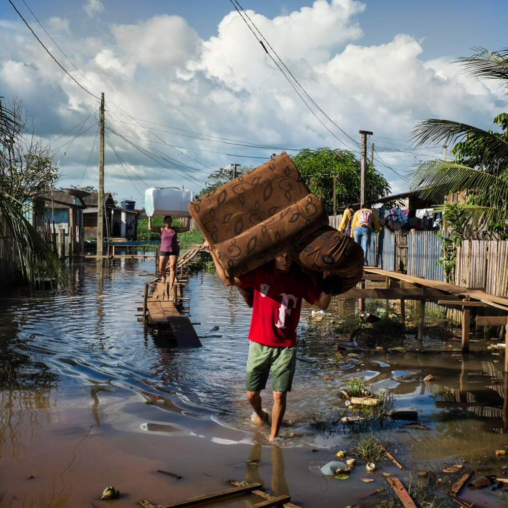 March 14, 2014. A family moves their belonging out of their flooded home in Invasao dos Padres, a neighbourhood in Altamira that will be permanently flooded by the Belo Monte Dam.