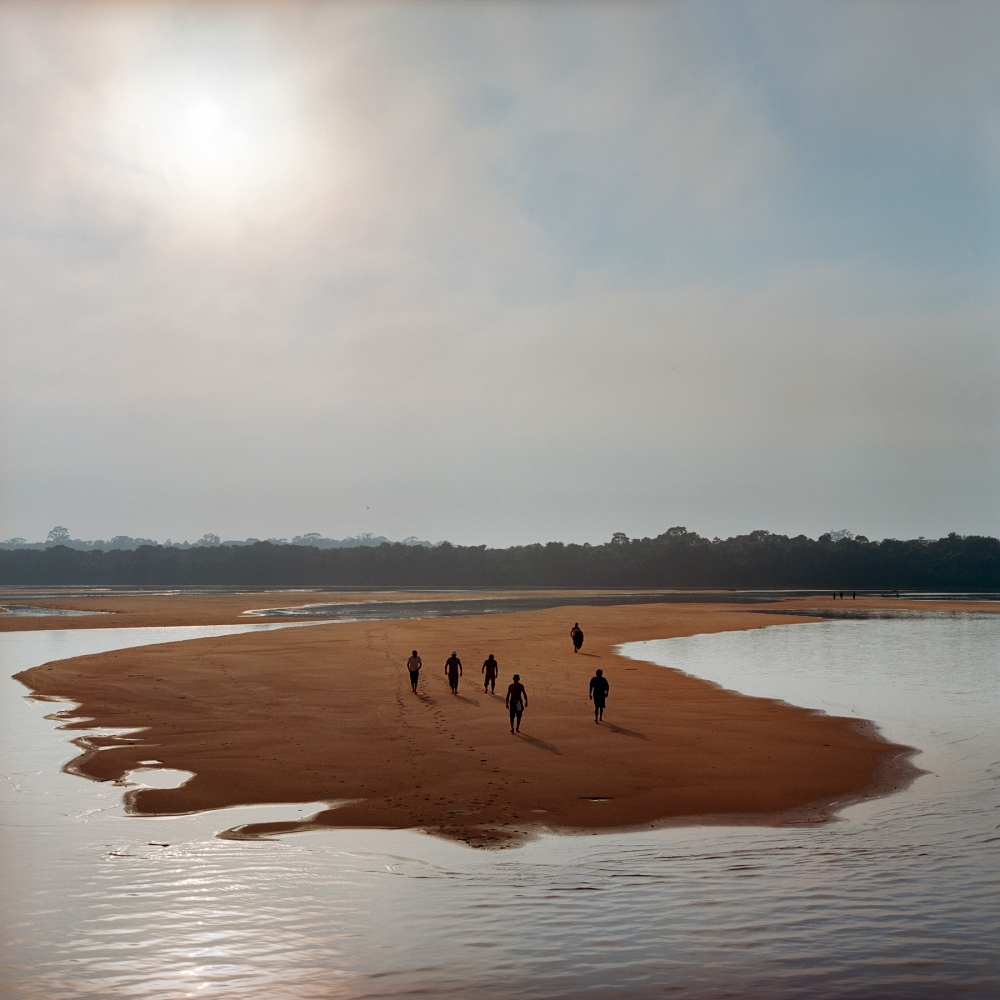 NOVEMBER 26, 2014. Members of the Munduruku indigenous tribe are seen on the Tapajos River in preparation for a protest against plans to construct a series of hydroelectric dams on the river in the Amazon rainforest in Para State, Brazil. The tribe members used the rocks to write 'Tapajos Livre' (Free Tapajos) in a large message in the sand in an action in coordination with Greenpeace. The Munduruku live traditionally along the river and depend on fishing and the river system for their livelihood. The proposed dams will flood indigenous lands and national parks including Munduruku villages.  Brazil is planning over 60 Dams for the Amazon Rainforest. The dams are part of Brazil's Growth Acceleration Programme (PAC), which also includes a rapid expansion of mining in the Amazon.