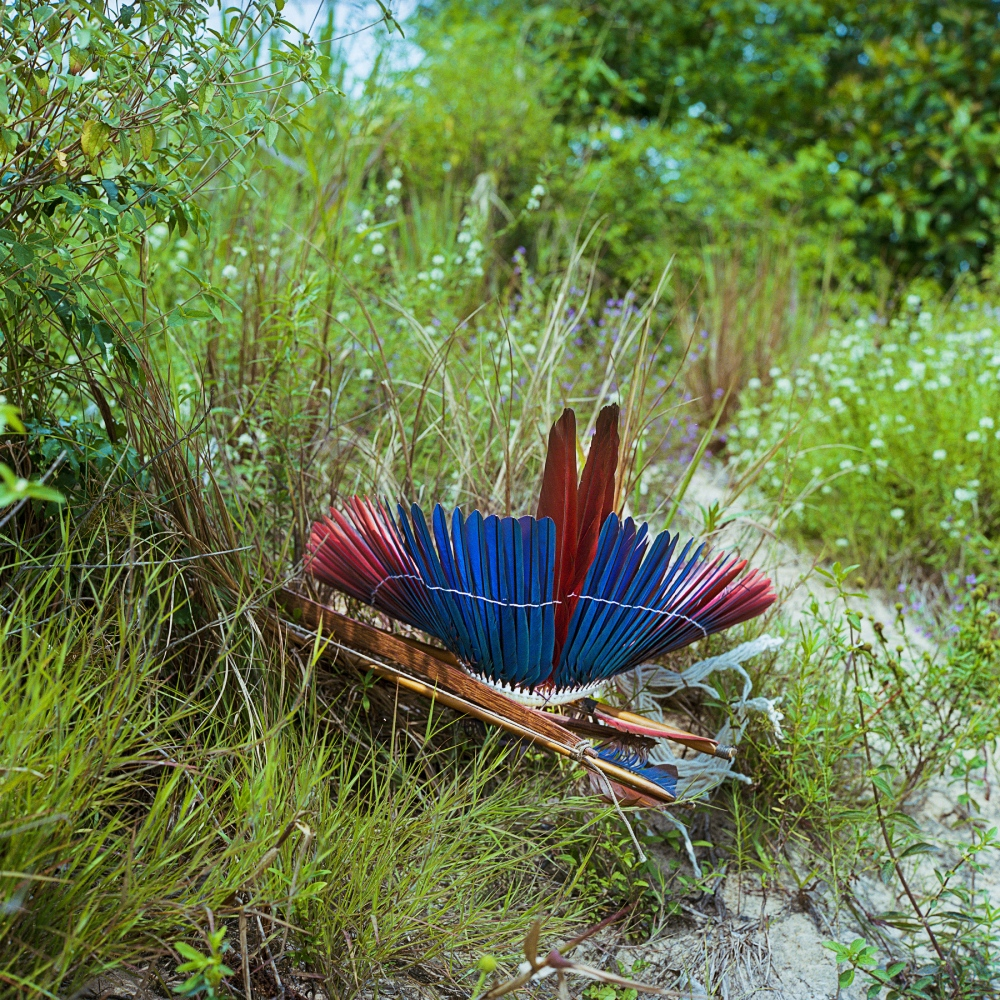 NOVEMBER 27, 2014. A Munduruku headdress rests on the beach of São Luiz do Tapajós during the 'Caravan of Resistance' protest against government plans to construct a series of hydroelectric dams on the Tapajos River in Para State, Brazil. The dams will flood a large portion of Munduruku traditional lands and impact the river ecosystem.