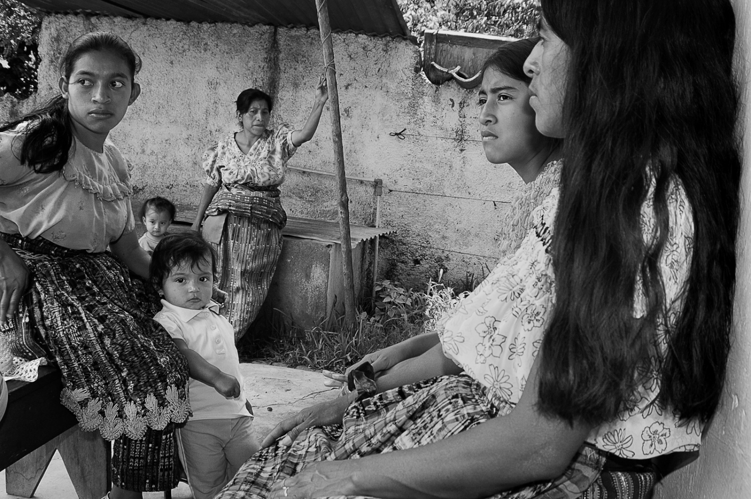 Patients waitng to be seen by a healer. People travel from faraway villages to be seen by the healers of San Pedro. Even though the practice of healing is common throughout Guatemala, the healers and bonesetters of San Pedro are particularly renowned.