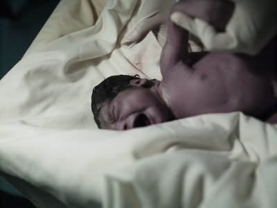 Alicias newborn son weighs in at only around 2kg. Because he was carried to term he still stands a good chance at survival, but he will most like be more susceptible to disease and may have other complications too.