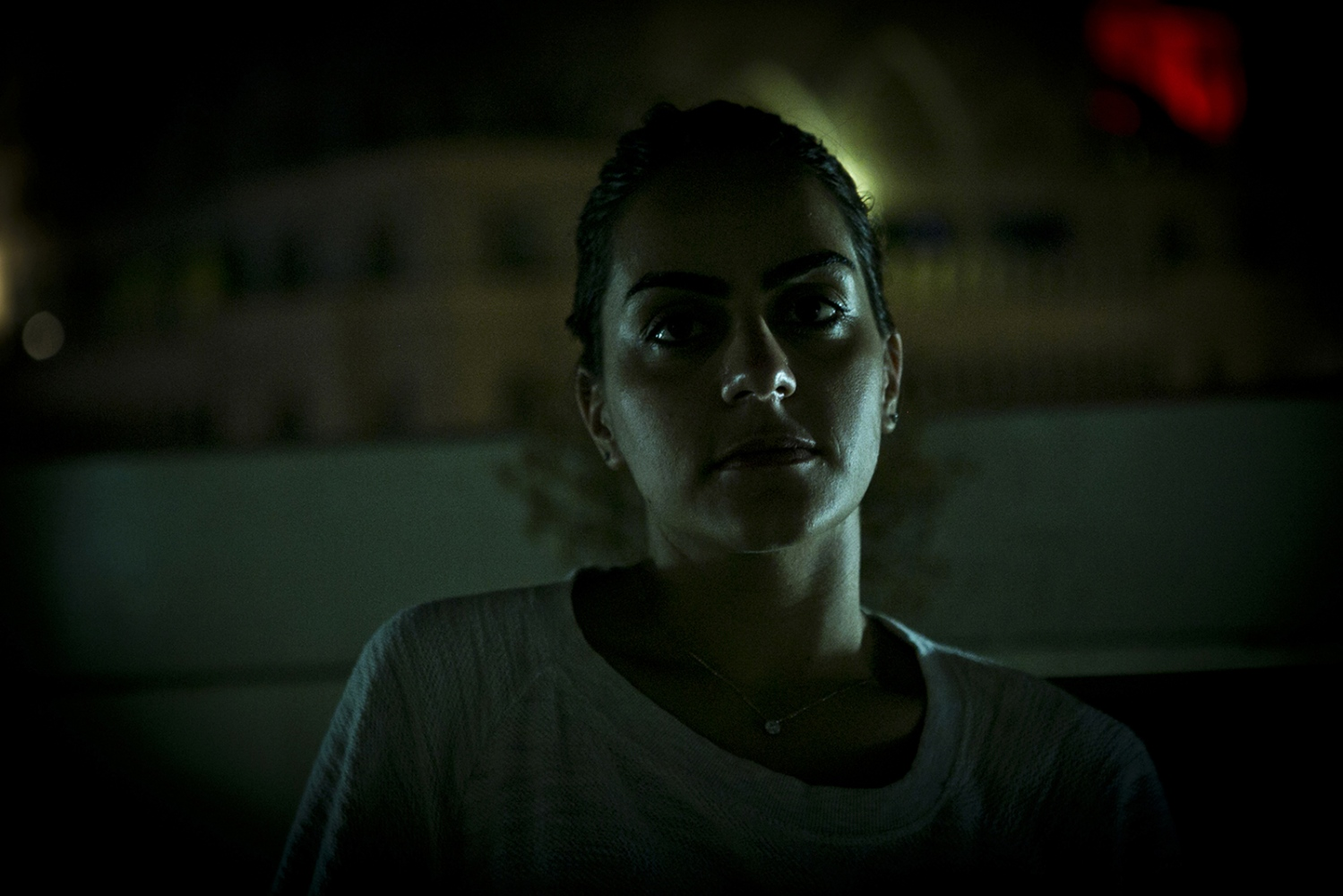 "DOHA, QATAR- 21 OCTOBER 2014 Diana relaxes on a residential rooftop after work- she often recalls memories from Syria, comparing everyday places, events ""back home"". Photo by Natalie Naccache/Getty Image Reportage/ Magnum Foundation/Prince Claus Fund/ AFAC"