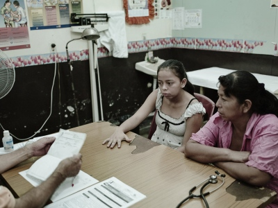 Gloria and her mother at her five month check-up at the local clinic.