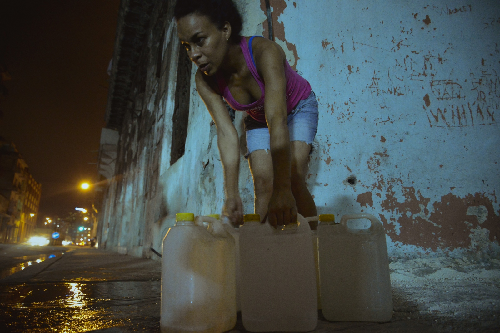 In the evening, Nidieska must gather gallons of water from a public water spigot five blocks from her home. Due to her AIDs and Osteoporosis, the journey is very difficult for her. Ariam usually helps Nidieska with the daily chore.