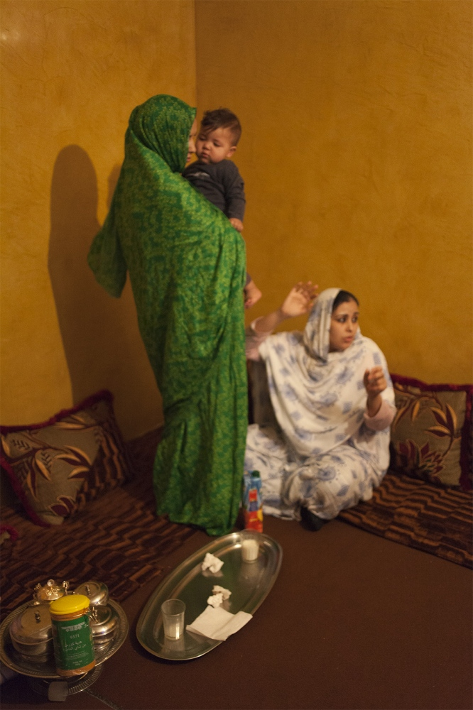 Two women with a child in an activist house in Laayoune.