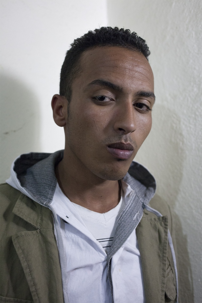 Ahmed (20). He has been arrested more times that he can remember. The last time it happened he was playing football and the police took him out in the desert and gave him electro shock and poured an unknown substance in his eyes so he went blind for two hours. The lashes on his eye has turned white.